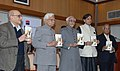 "Mohd. Hamid Ansari releasing the book entitled ""Walking with Lions Tales from a Diplomatic Past"" written by Shri K. Natwar Singh, in New Delhi. The Minister of State for Human Resource Development.jpg"