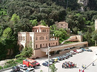 Santa Cova Funicular - The upper station of the Santa Cova funicular. The lower station of the Sant Joan funicular can be seen in the background, and the rack railway upper terminus is below the car park.
