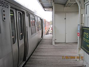 Morse station - A northbound train enters the station, passing close to the metal guardrail.  The stroller is alleged to have struck a similar railing as the train left the station.