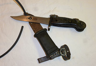 Bayonet - Multi-purpose AKM Type I bayonet of the Nationale Volksarmee shown cutting a wire when combined with its scabbard