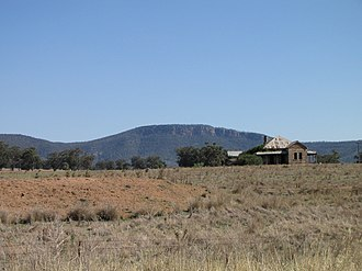 Murga, New South Wales - An abandoned homestead at Murga in front of the cliffs of Nangar National Park, as seen from the Escort Way