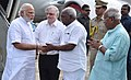 Narendra Modi being received by the Governor of Kerala, Justice (Retd.) P. Sathasivam and the Minister of State for Road Transport & Highways and Shipping, Shri P. Radhakrishnan on his arrival (1).jpg