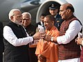 Narendra Modi being welcomed by the Governor of Uttar Pradesh, Shri Ram Naik, the Union Home Minister, Shri Rajnath Singh and the Chief Minister of Uttar Pradesh, Yogi Adityanath, on his arrival, in Lucknow, Uttar Pradesh.jpg