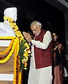 Narendra Modi paying floral tributes at the statue of Pt. Madan Mohan Malviya at BHU, in Varanasi, Uttar Pradesh on December 25, 2014. The Union Minister for Human Resource Development, Smt. Smriti Irani is also seen.jpg
