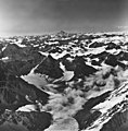 Neacola mountains, unknown mountain glaciers in the foreground, Iliamna Volcano in the background, September 4, 1966 (GLACIERS 6595).jpg