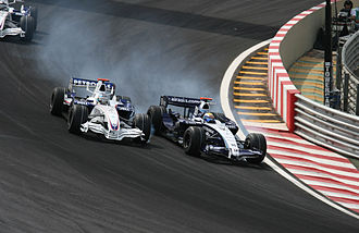 Overtaking - Nico Rosberg overtaking Nick Heidfeld in the 2007 Brazilian Grand Prix - a Formula One race.