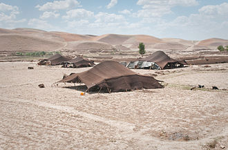 Afghan (ethnonym) - Tents of Afghan nomads in Badghis Province of Afghanistan who are known in Pashto language as Kuchans. They are mostly Ghilji and migrate from region to region depending on the season. Early peasant farming villages came into existence in Afghanistan about 7000 years ago.