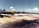 North American SNJ-3 and Brewster F2A-3 trainers at Naval Air Station Miami, circa in 1942 (80-G-K-13384).jpg