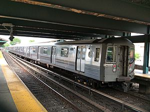 B (New York City Subway service) - A train made of R68 cars in B service at Kings Highway, bound for Manhattan.