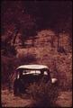 OLD CAR ABANDONED ON A RANCH NEAR LEAKEY, TEXAS, AND SAN ANTONIO - NARA - 554920.tif