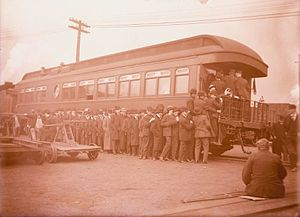 Pittsburgh and Lake Erie Railroad - View of men in line at the pay car of the Pittsburgh and Lake Erie Railroad Company