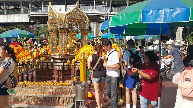 People praying to Lord Brahma, a Hindu deity, at the Erawan shrine, Bangkok People praying at Erawan Shrine 2018.jpg
