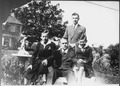 Photograph of Gerald R. Ford, Jr., Flanked by Richard A. Ford, and James F. Ford, with Thomas G. Ford Standing Behind... - NARA - 186915.tif