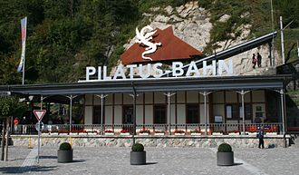 Pilatus Railway - Alpnachstad station; note the inclination of the platform behind the building