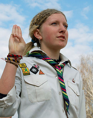 Scout sign and salute - Ukrainian Girl Scout from Plast making the Scout Sign.