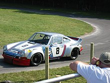 Photo d'une Porsche 911 Carrera RSR en course.