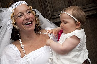 Rusby with her daughter at her 2010 wedding to fellow musician Damien O'Kane Portraits (Kate Rusby).jpg