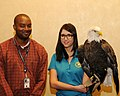 Posing for picture with Bald Eagle. (10596677965).jpg