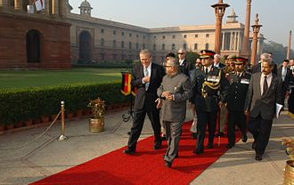Pranab Mukherjee - Defence Minister Mukherjee escorts Secretary of Defense Donald H. Rumsfeld as he arrives at the South Block building in New Delhi, 2004.
