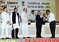 Pranab Mukherjee presenting the National Award for Teachers-2012 to Ch. Nishakanta Singh, Manipur, on the occasion of the 'Teachers Day', in New Delhi. The Union Minister for Human Resource Development.jpg