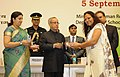 Pranab Mukherjee presenting the National Award for Teachers-2013 to Smt. Sunita Nandal, Haryana, on the occasion of the 'Teachers Day', in New Delhi. The Union Minister for Human Resource Development.jpg