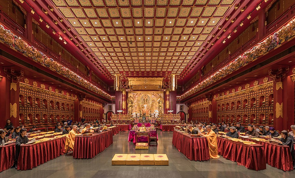Praying monks and nuns in the Buddha Tooth Relic Temple of Singapore