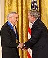President George W. Bush congratulates Stan Lee.jpg