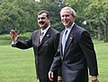 President George W. Bush walks with Pakistani Prime Minister Syed Yousaf Raza Gillani.jpg