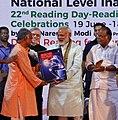 Prime Minister Narendra Modi releasing Yoga Paithrukam special edition.jpg