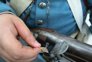 Priming a Mexican War era flintlock.jpg