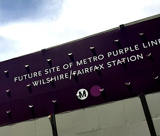 Purple Line Extension - Signage announcing the construction of Wilshire/Fairfax station in Miracle Mile