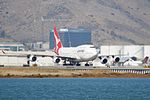 Qantas Boeing 747-400 taxiing back from the end of the runway (31255682341).jpg
