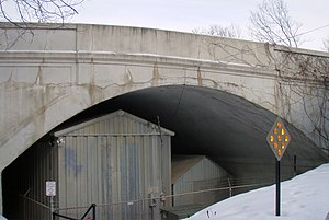 Queen Avenue Bridge - The southwest side of the bridge with the sheds underneath used for the Minnesota Streetcar Museum cars