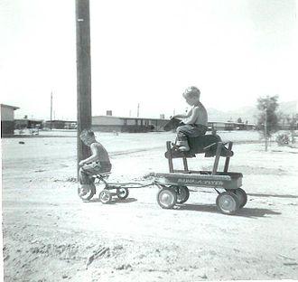 Radio Flyer - Radio Flyer wagon, tricycle and hobby horse circa 1960.