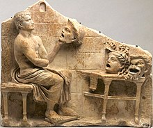 Roman relief showing Menander with masks depicting New Comedy characters: youth, false maiden, and the old man.