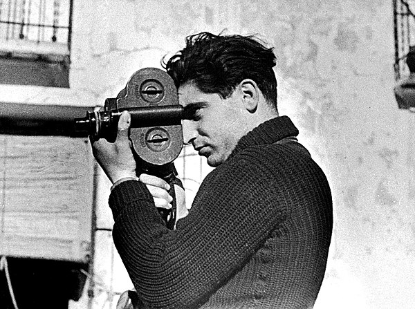 Robert Capa in Spain using a Filmo 16 mm film camera in 1937