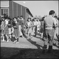 Rohwer Relocation Center, McGehee, Arkansas. Changing classes at the temporary high school quarters. - NARA - 538925.tif