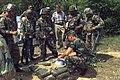 SGT Lance G. Halston demonstrates the proper way to place a land mine to U.S. Senator James Inhofe.jpg