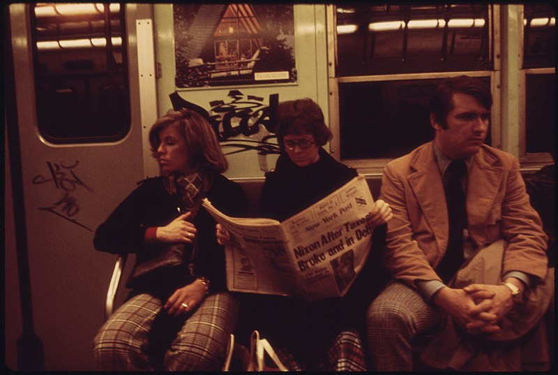 File:SUBWAY RIDERS LOST IN THEIR OWN THOUGHTS AND READING THE NEWSPAPER ON THE LEXINGTON AVENUE LINE OF THE NEW YORK CITY... - NARA - 556666.jpg