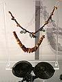 Sabini adriatici, ornamenti dalla tomba femminile 33 di case pecci (tortoreto), 810-700 ac ca., collana con pendenti a occhiali e fibula.jpg