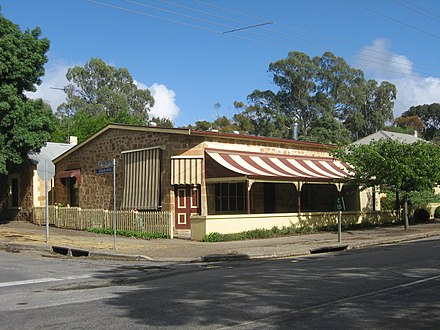 Joseph Bennett's home and saddlery shop, 1853 to 1873, at corner Main North Road and St Vincent Road, Watervale, South Australia. Bennett was also postmaster, registrar of births deaths and marriages, and special constable. Saddlery shop at Watervale, South Australia, opened 1853 by Joseph Bennett (1823-1873).jpg