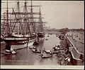 Sailing ships and other boats docked along the Hooghly River in Calcutta.jpg