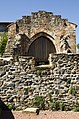 Sain Bel - Eglise - Mur et ancienne porte.jpg