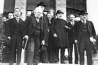San Remo conference - Delegates to the Conference standing outside Villa Devachan, from left to right: Matsui, Lloyd George, Curzon, Berthelot, Millerand, Scialoja, Nitti