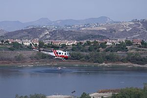 Orange County Fire Authority - OCFA helicopters filling their water tanks at Upper Oso Reservoir during the Santiago Fire (2007)