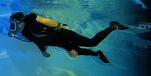Full face diving mask - A diver in a pool wearing an AGA full face mask