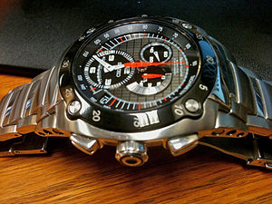 Automatic quartz - Seiko SNL043 Kinetic Chronograph using a 7L22 caliber Kinetic movement with flyback chronograph.