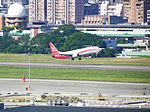 Shanghai Airlines B-2168 Taking off from Taipei Songshan Airport 20121220.jpg