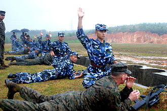 People's Liberation Army Navy - PLA (N) Marines of the 1st Marine Brigade and members of the USMC fire the Type 95 Assault Rifle during an exchange exercise.