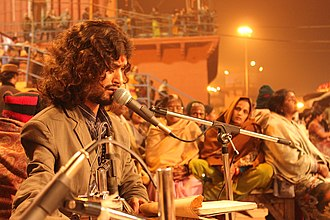 Dashashwamedh Ghat - Singer reciting prayer during Ganga Aarti at Dashashwamedh Ghat.